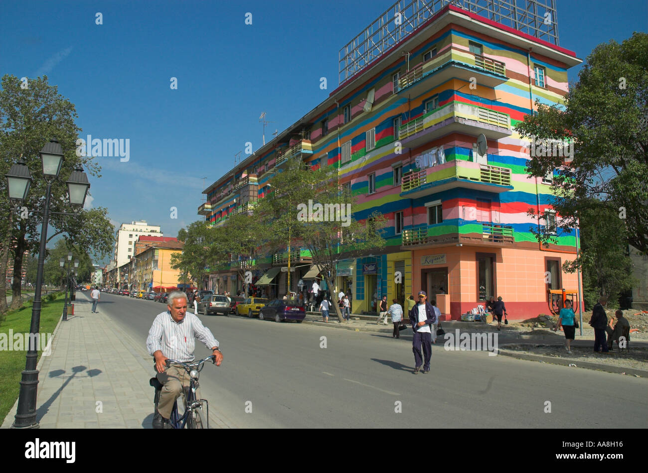 Albania Tirana Downtown Bajram Curri boulevard view with road and freshly repainted building in bright colours - Stock Image