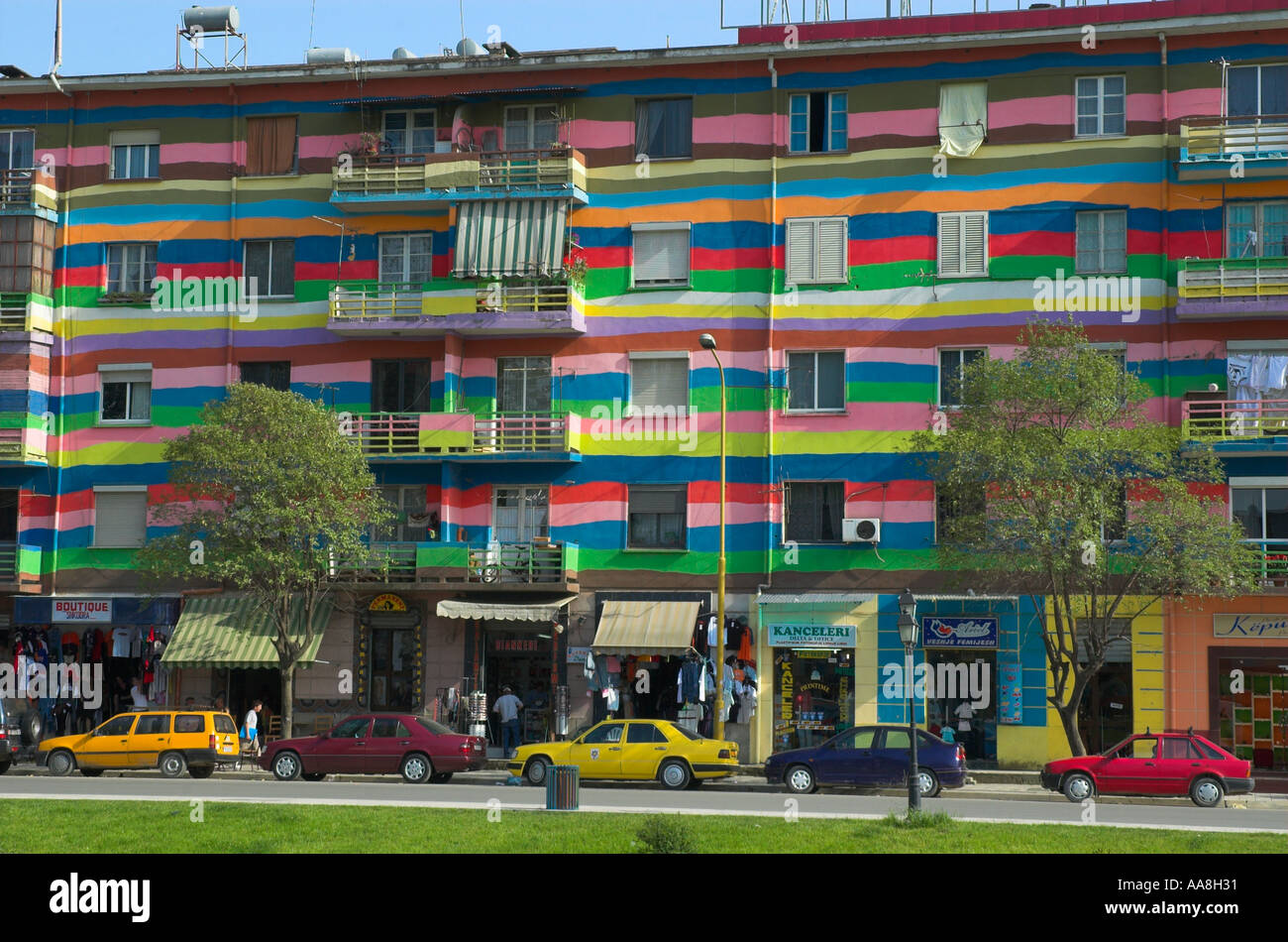 Albania Tirana Downtown Bajram Curri boulevard freshly repainted building in bright colours  - Stock Image