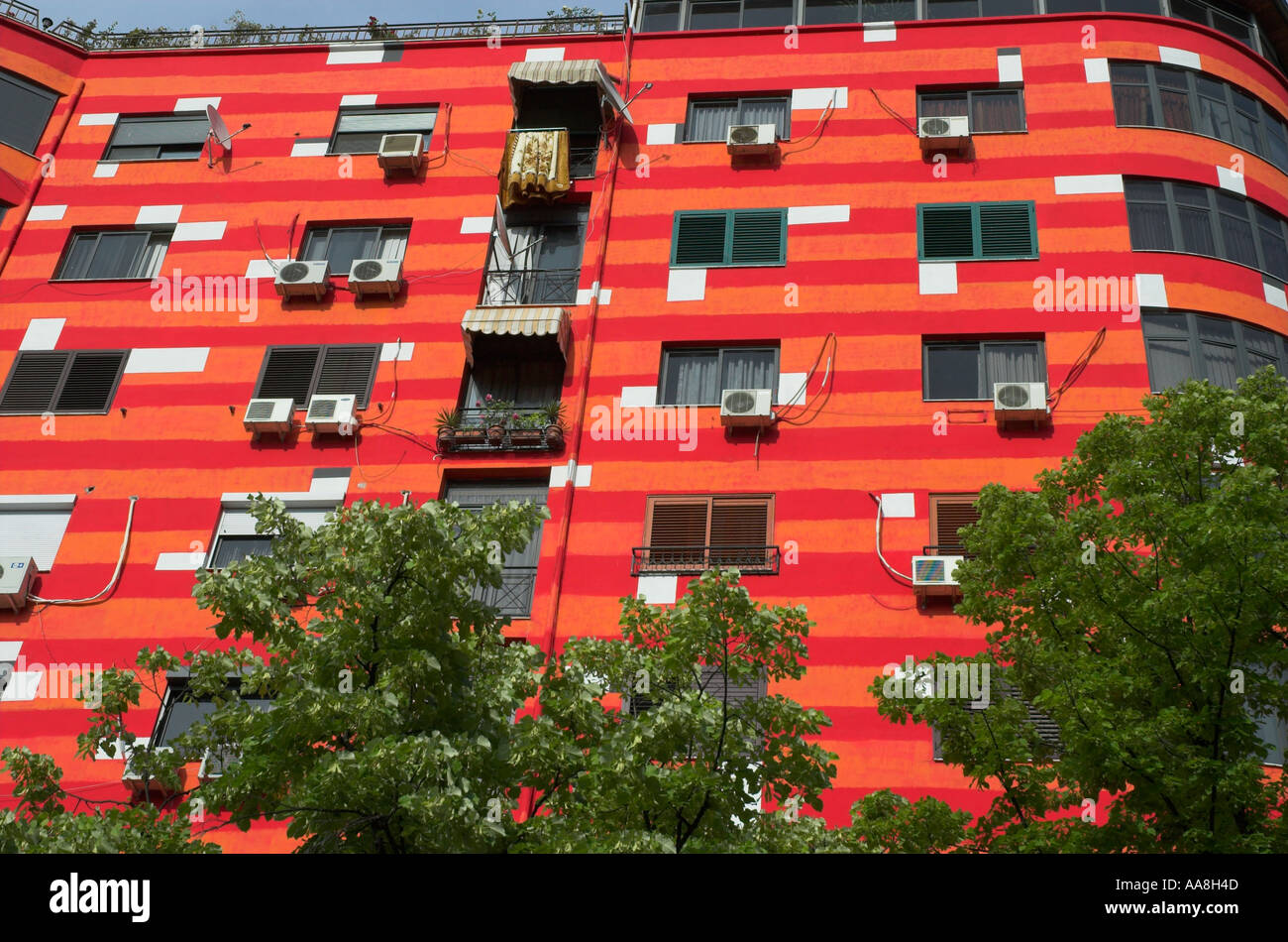 Albania Tirana Downtown Blloku close up of repainted housing buildings in bright red and orange paint - Stock Image