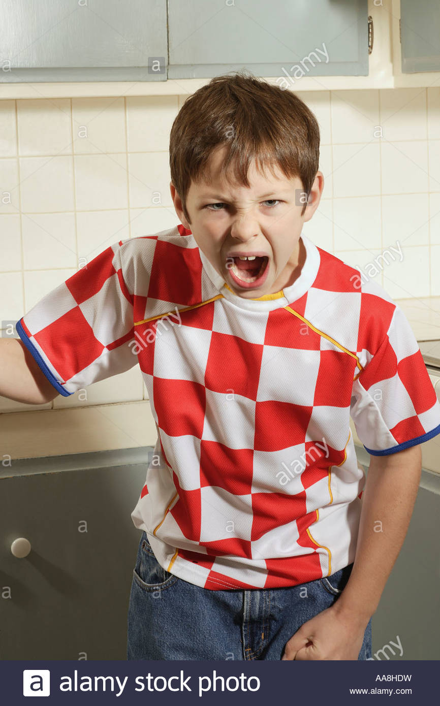 Young boy shouting - Stock Image