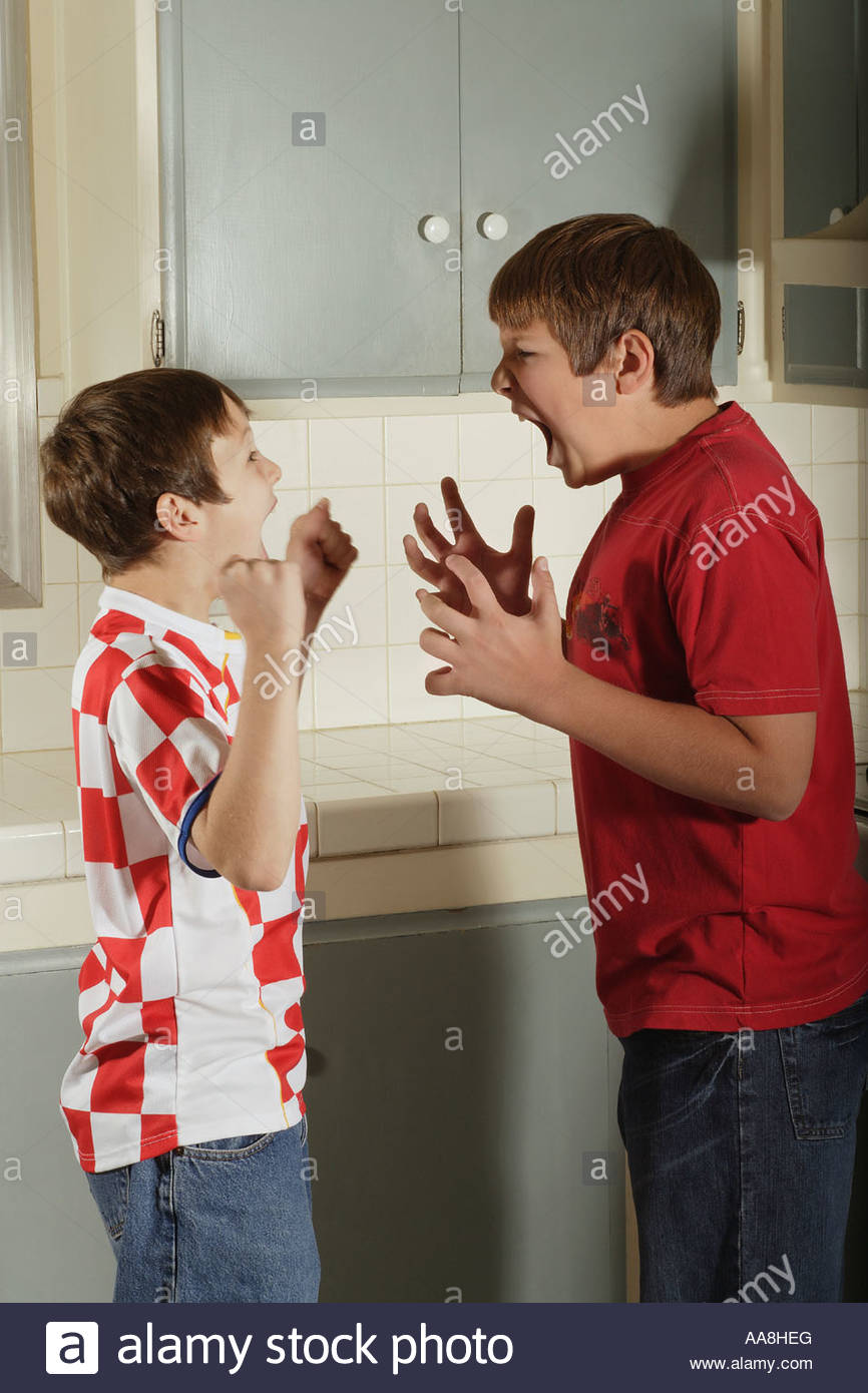 Young boys arguing - Stock Image