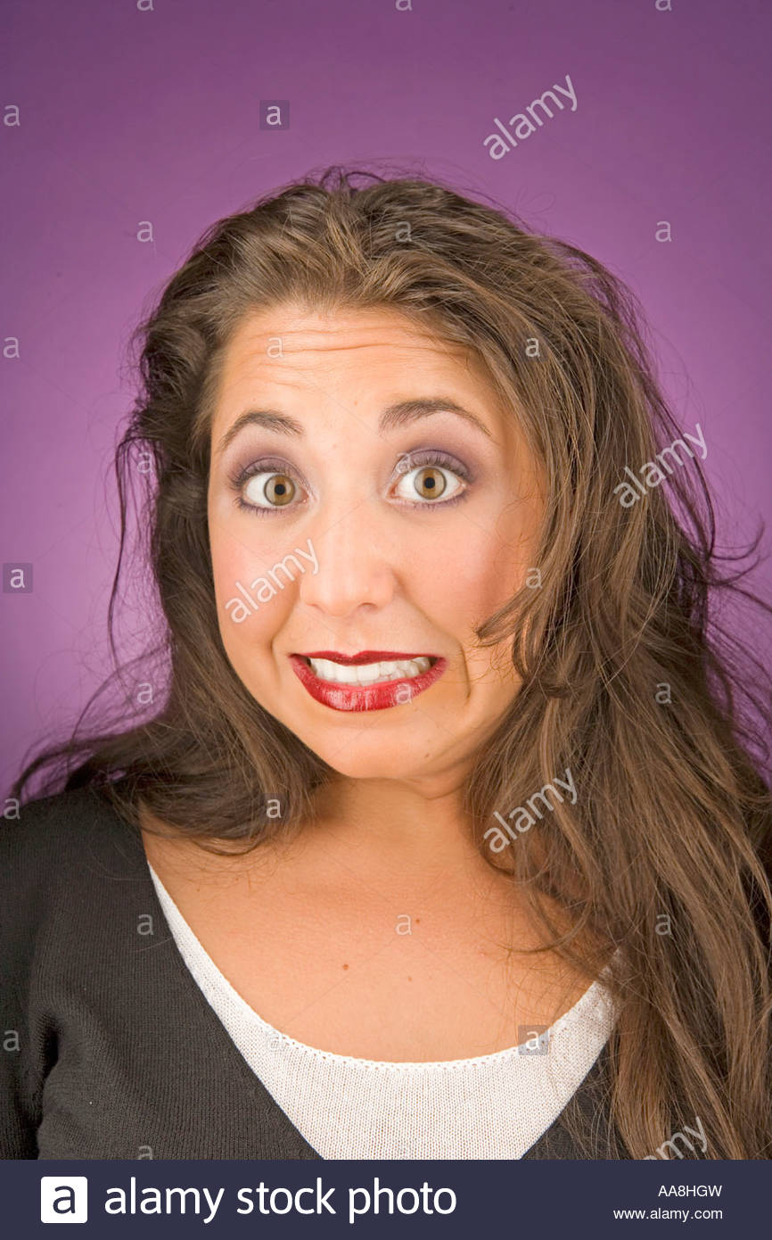 Young woman gritting her teeth - Stock Image
