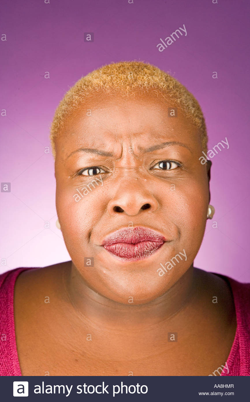 Young woman frowning - Stock Image