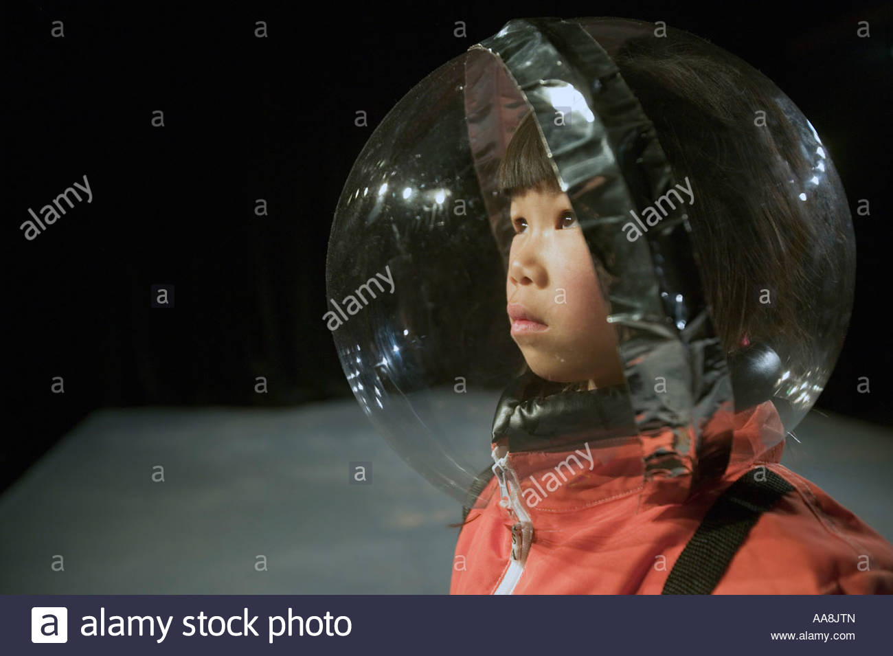 Young Asian boy in astronaut costume - Stock Image