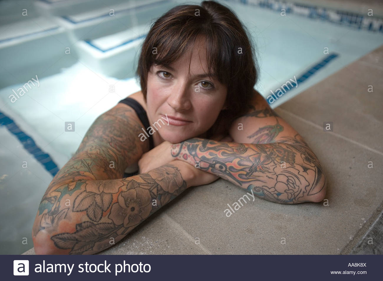 Woman with tattooed arms in hot tub Stock Photo  12550489 - Alamy a6b89fbd4fe2