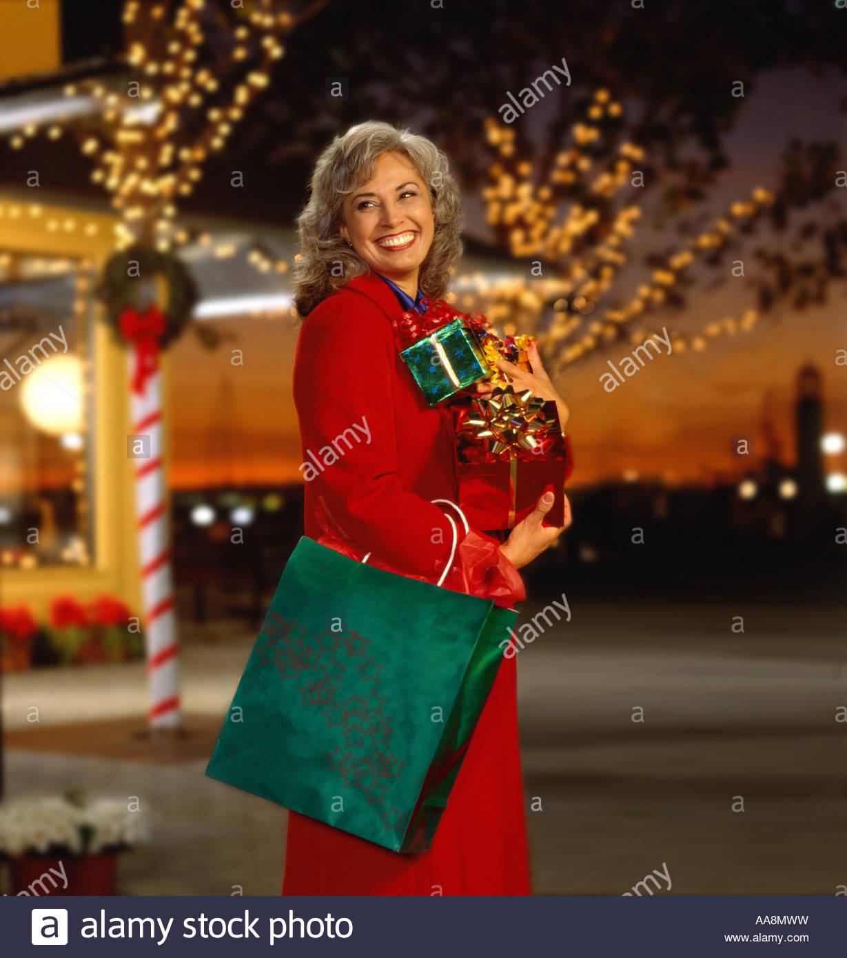 Woman Christmas Outside Group Stock Photos & Woman