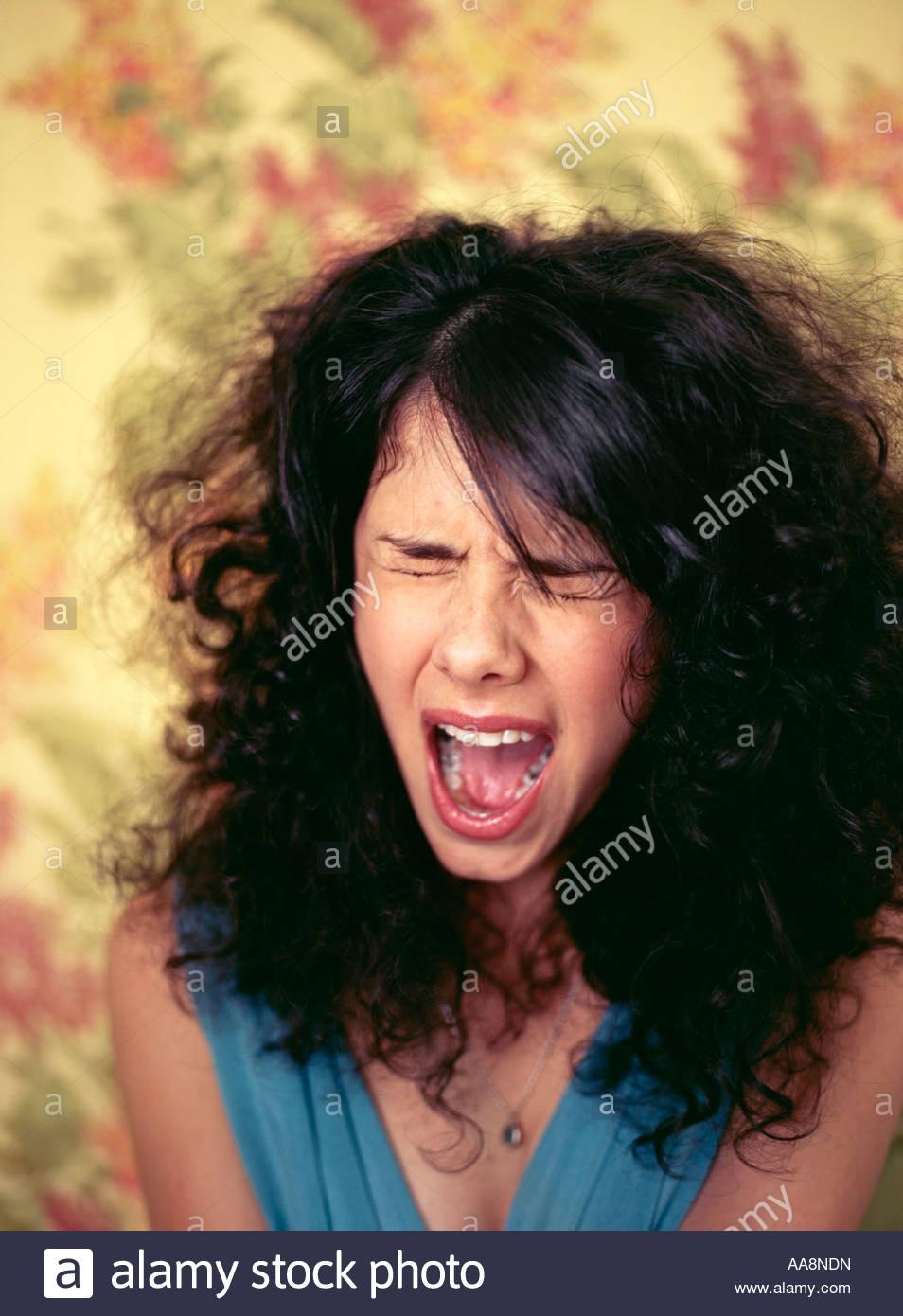 Hispanic woman shouting - Stock Image