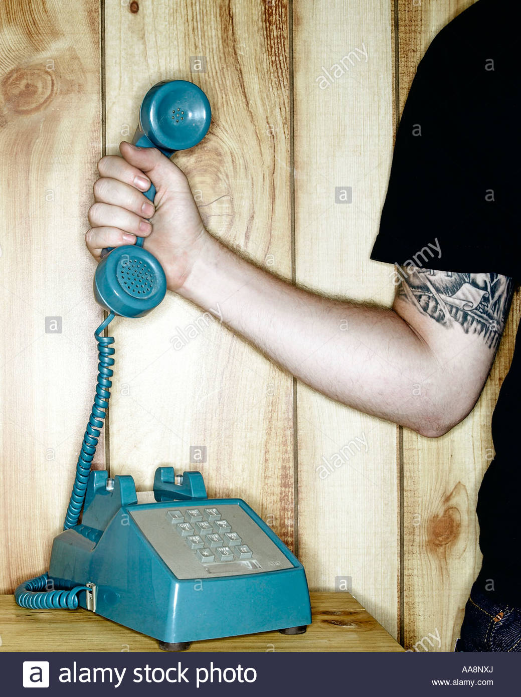 Hand holding old-fashioned phone receiver - Stock Image