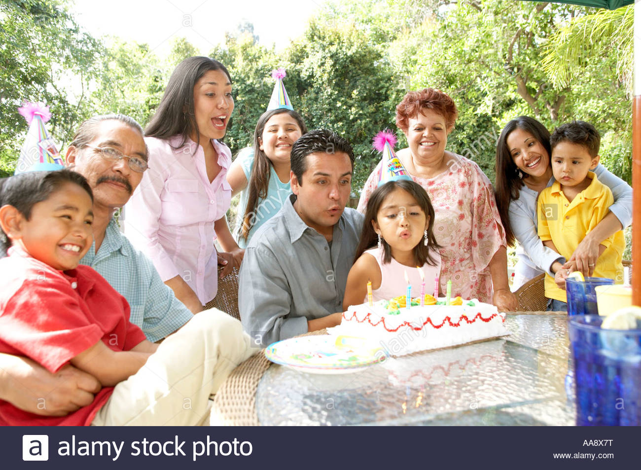 Extended Hispanic family at birthday party - Stock Image