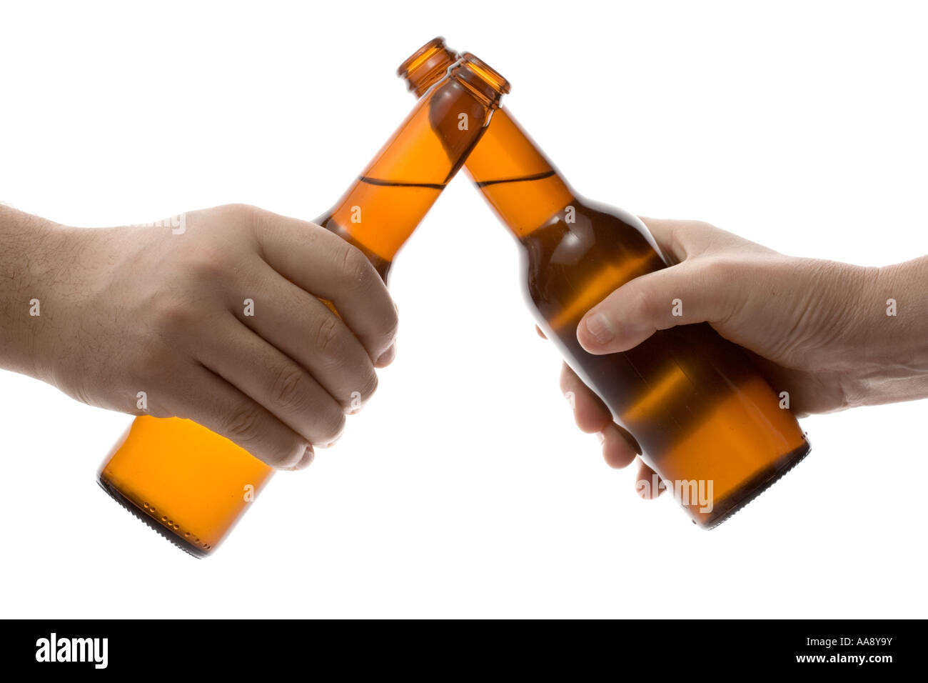 Two people holding a beer bottle Stock Photo: 12553190 - Alamy