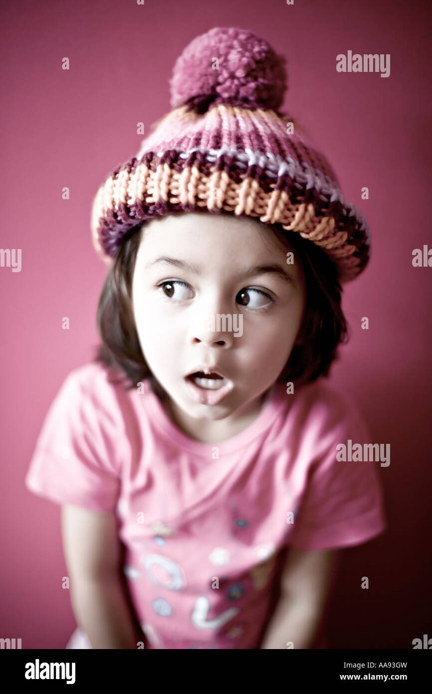 Girl in pink with bobble hat - Stock Image
