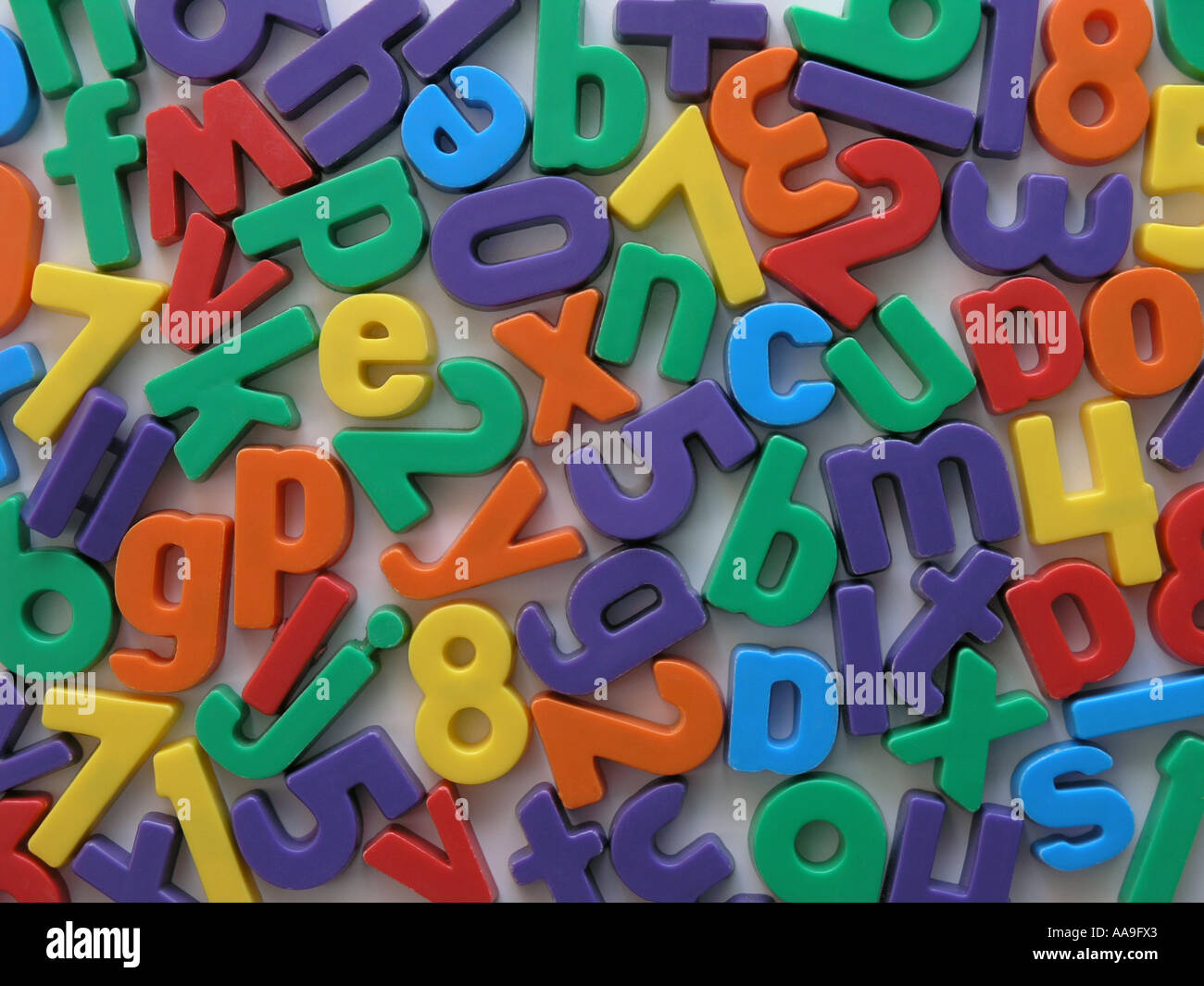 Magnetic letters and numbers on a fridge. Stock Photo