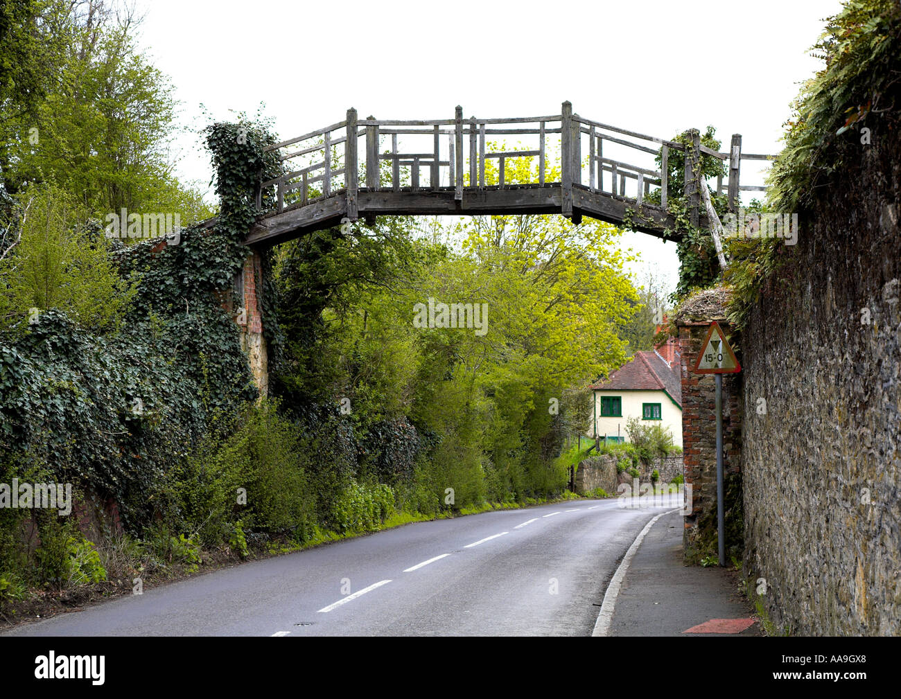 Old wooden bridge over the road in Shere SurreyStock Photo
