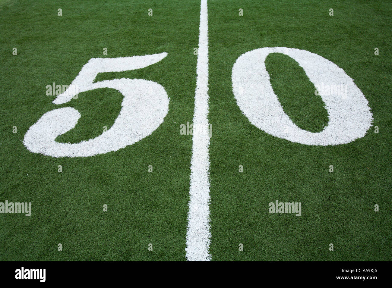 50 yard line on football field - Stock Image