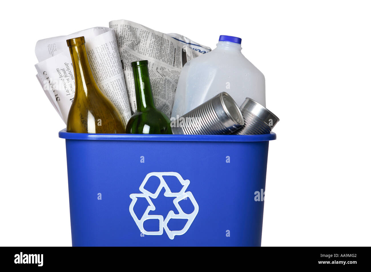 Recycle bin full of recyclable household items. - Stock Image