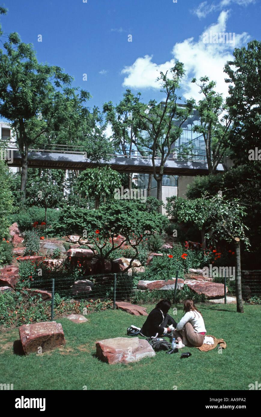Friends In The Jardin Rouge Parc Andre Citroen Paris Stock Photo
