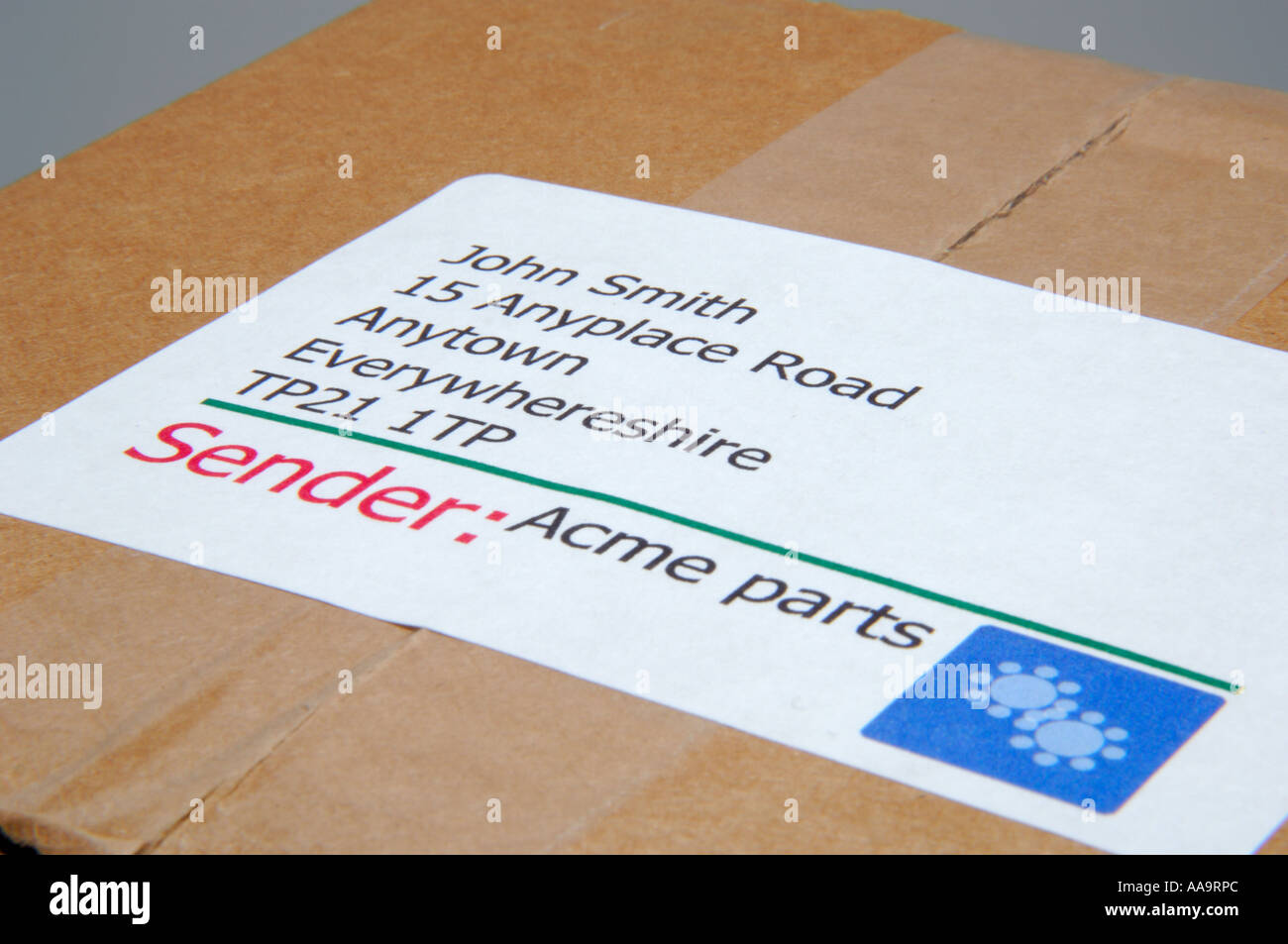 Close Up Of Address Label On A Cardboard Package Stock Photo