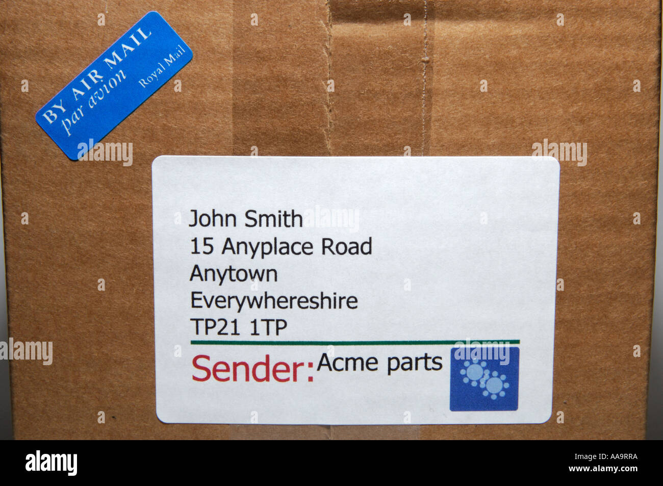 Close Up Of Address Label And Air Mail Label On A Cardboard Package