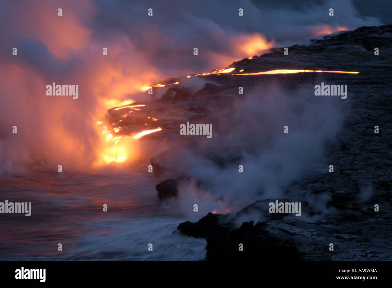 Lava flowing into the Pacific Ocean Volcanoes National Park Big Island Hawaii - Stock Image