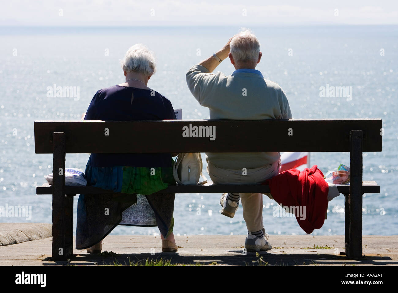 Elderly couple enjoying the view of the Irish Sea Aberystwyth County Ceredigion Wales UK May 2007 - Stock Image