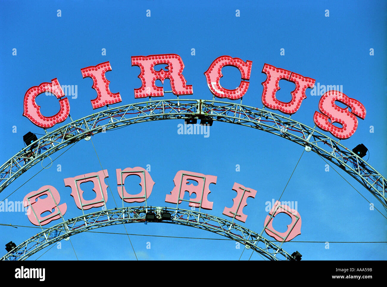 A circus sign with blue sky - Stock Image