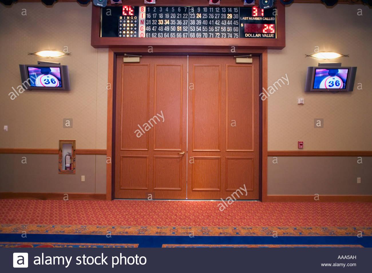 Doors beneath bingo board - Stock Image