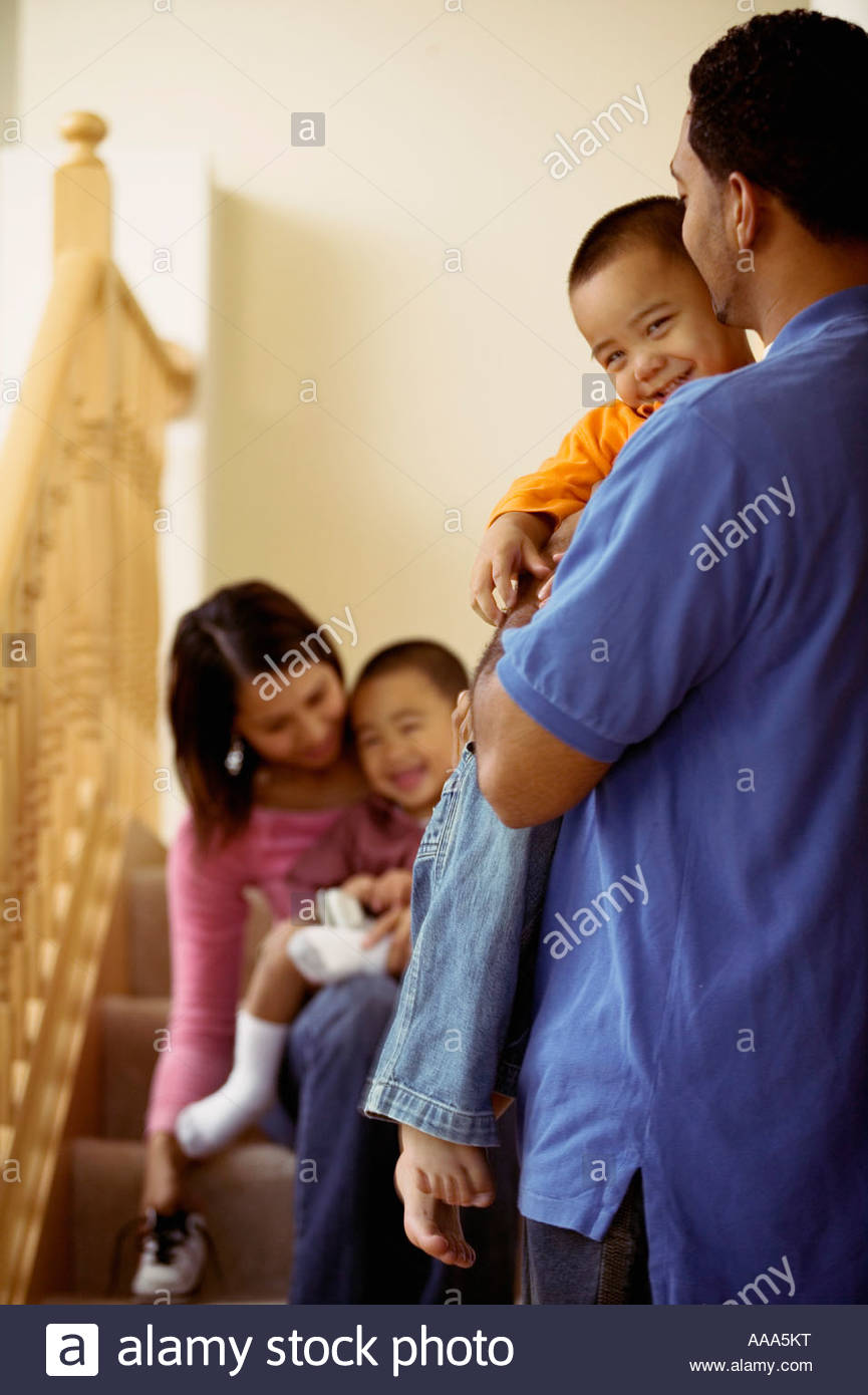 Asian parents holding children Stock Photo