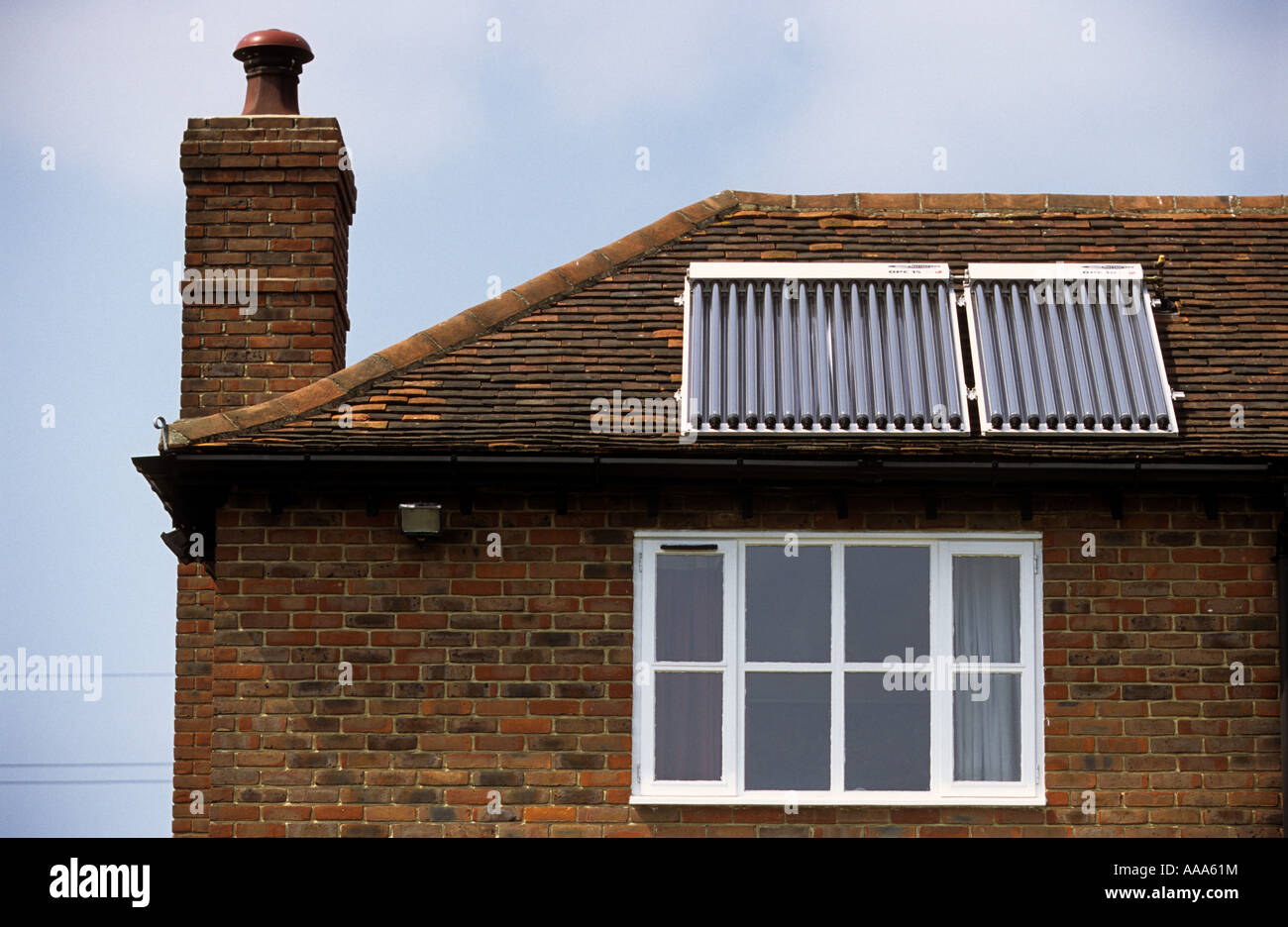 Photovoltaics or solar panels suppling hot water to a residential property in Braintree, Essex, UK. - Stock Image