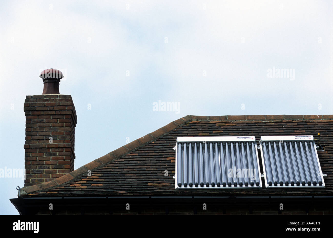 Solar thermal evacuated vacuum tubes supplying hot water to a residential propery in Braintree, Essex, UK. - Stock Image