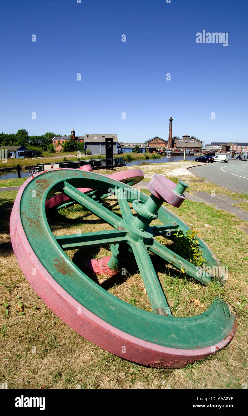 """Cast Iron"" Pulley Fly Wheels displayed on the Canalside at ""Ellesmere Port"",Cheshire,England,UK,GB. Stock Photo"