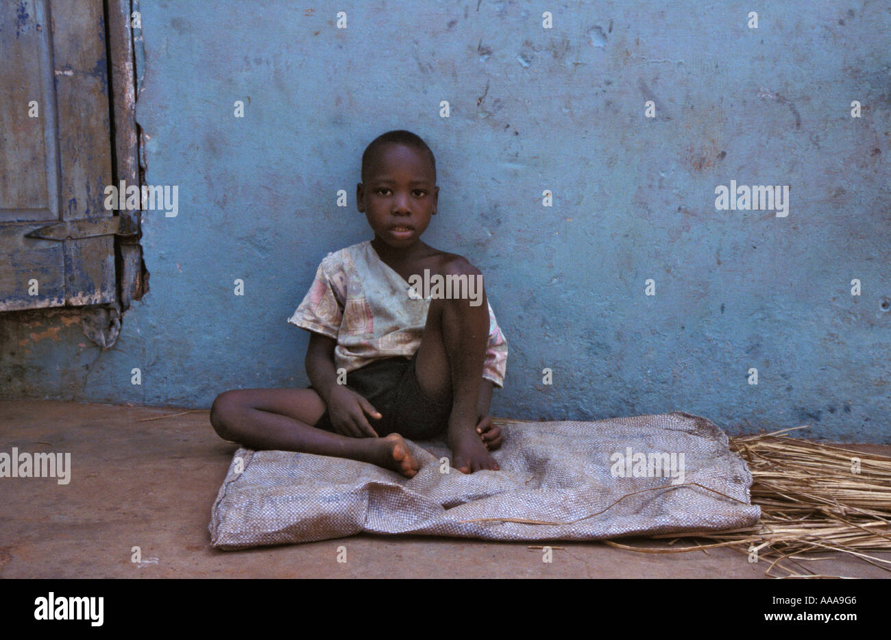 8933775217df5 Homeless little boy living on the streets of Accra
