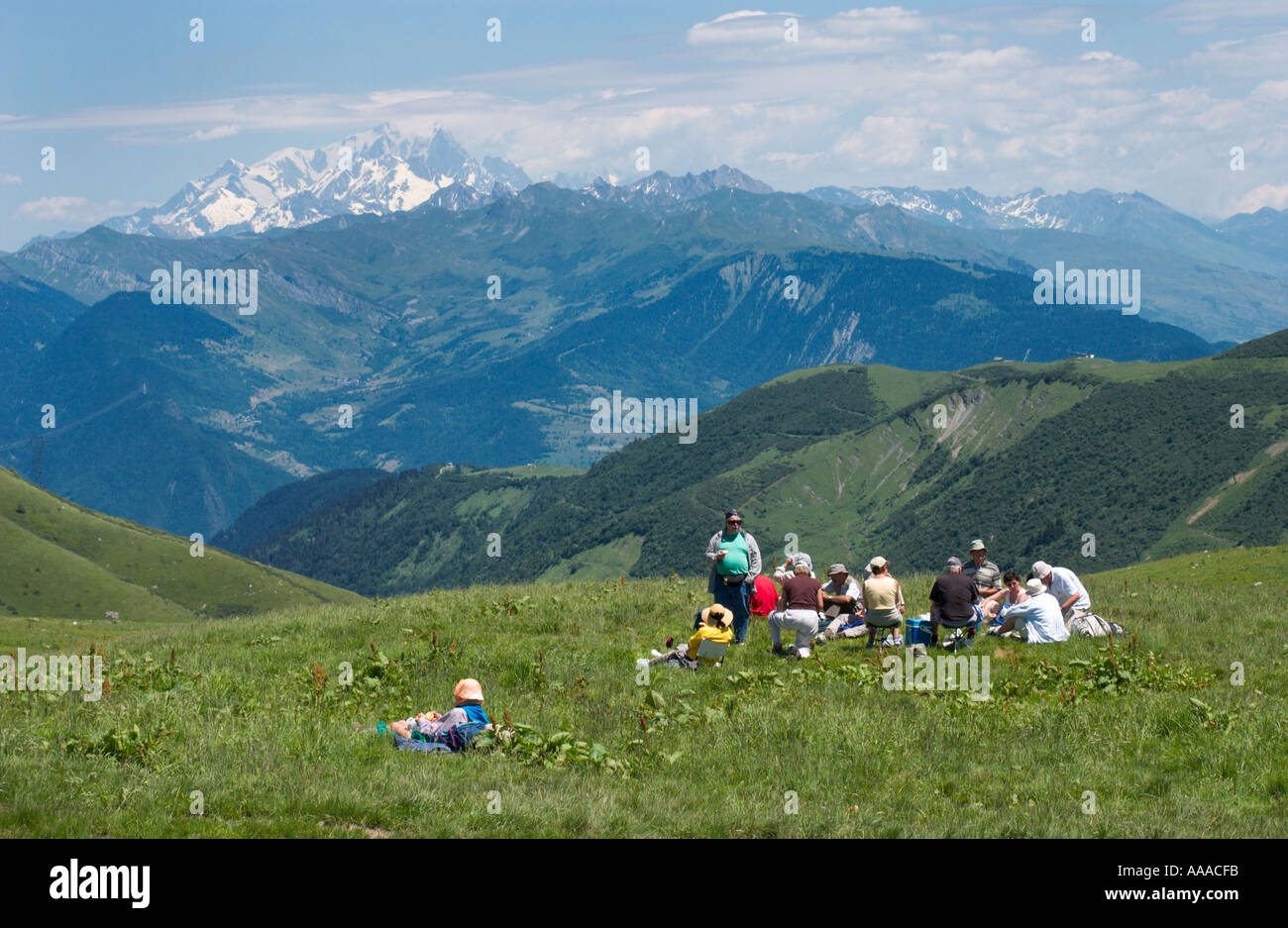 a group of hikers have a picnic on the Col de la Madeleine with view of the Mont Blanc, Department Savoie, french Alps,France Stock Photo