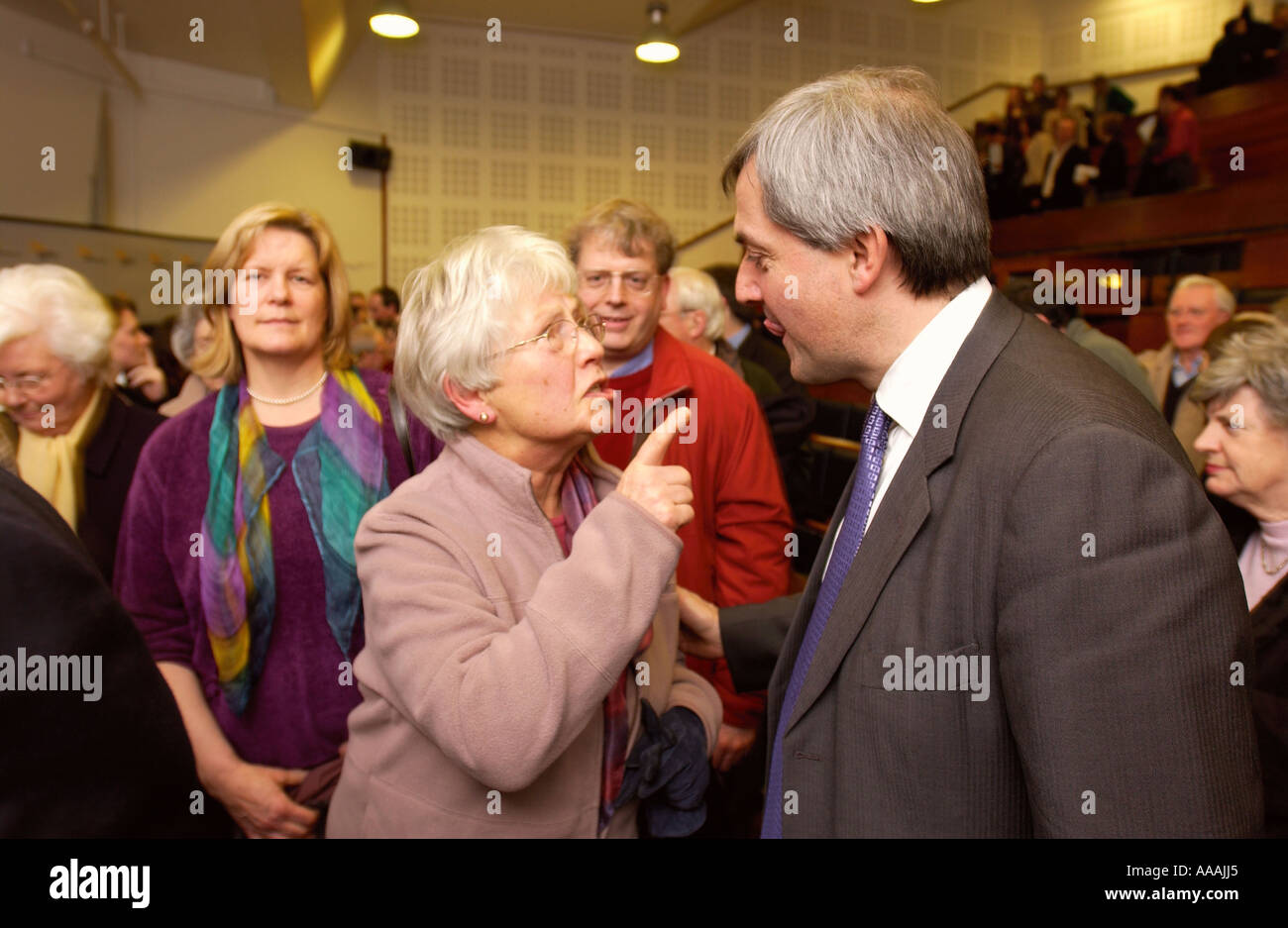 A LIBERAL DEMOCRAT MEMBER REMONSTRATES WITH LEADERSHIP CONTENDER CHRIS HUHNE - Stock Image