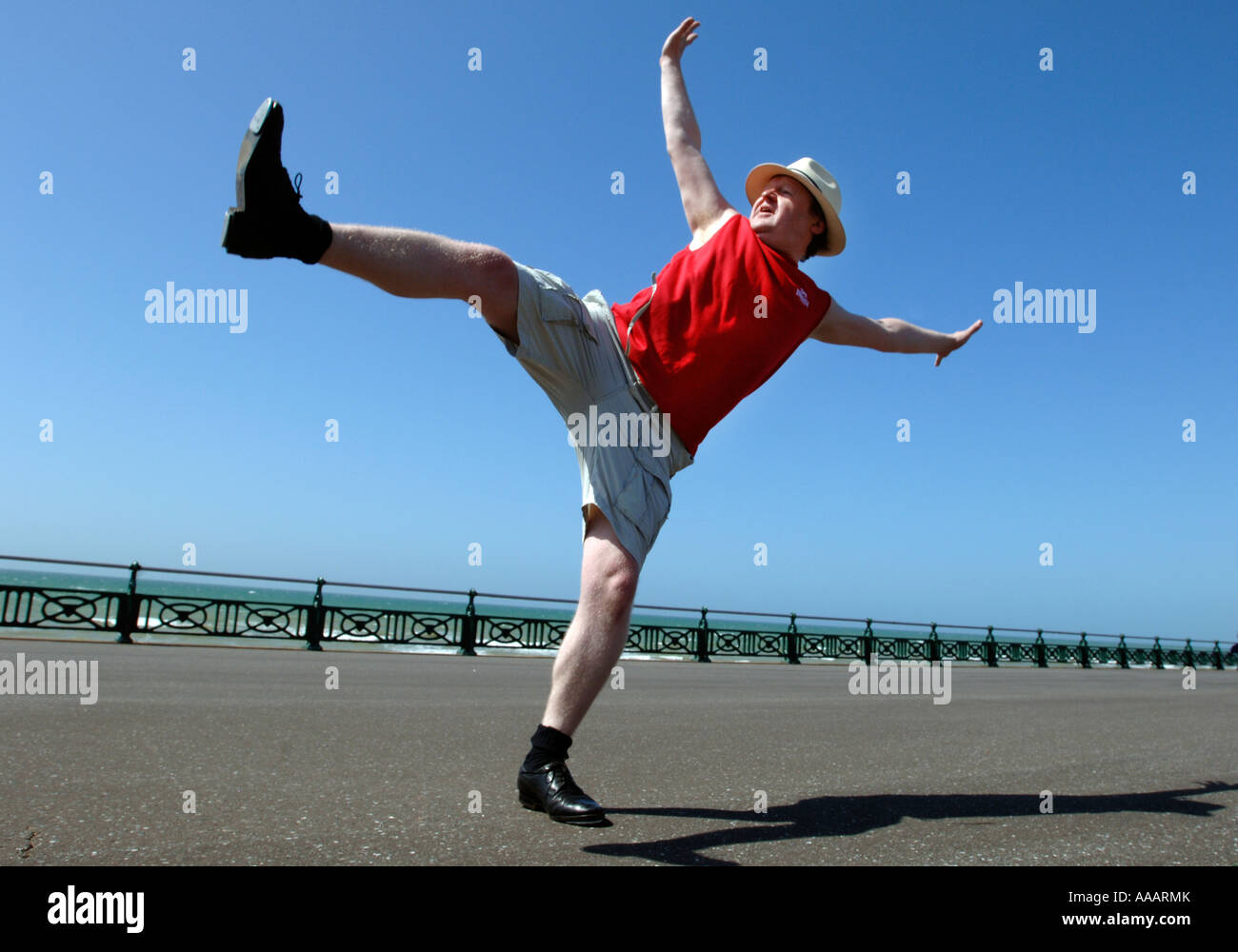 One Overweight Middle Aged Man Doing Clumsy High Kicking Dance Routine On  Brighton Seafront   Stock