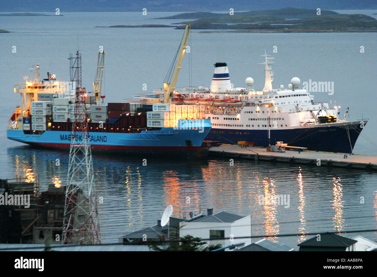 A Maersk commercial ship lies in Ushuaia port opposite Antarctic