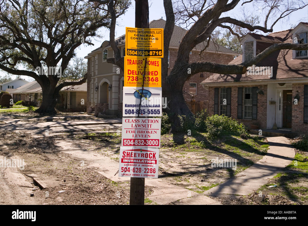 Advertising placards promoting services in the Lakewood neighborhood of New Orleans Louisana showing Hurricane Katrina - Stock Image