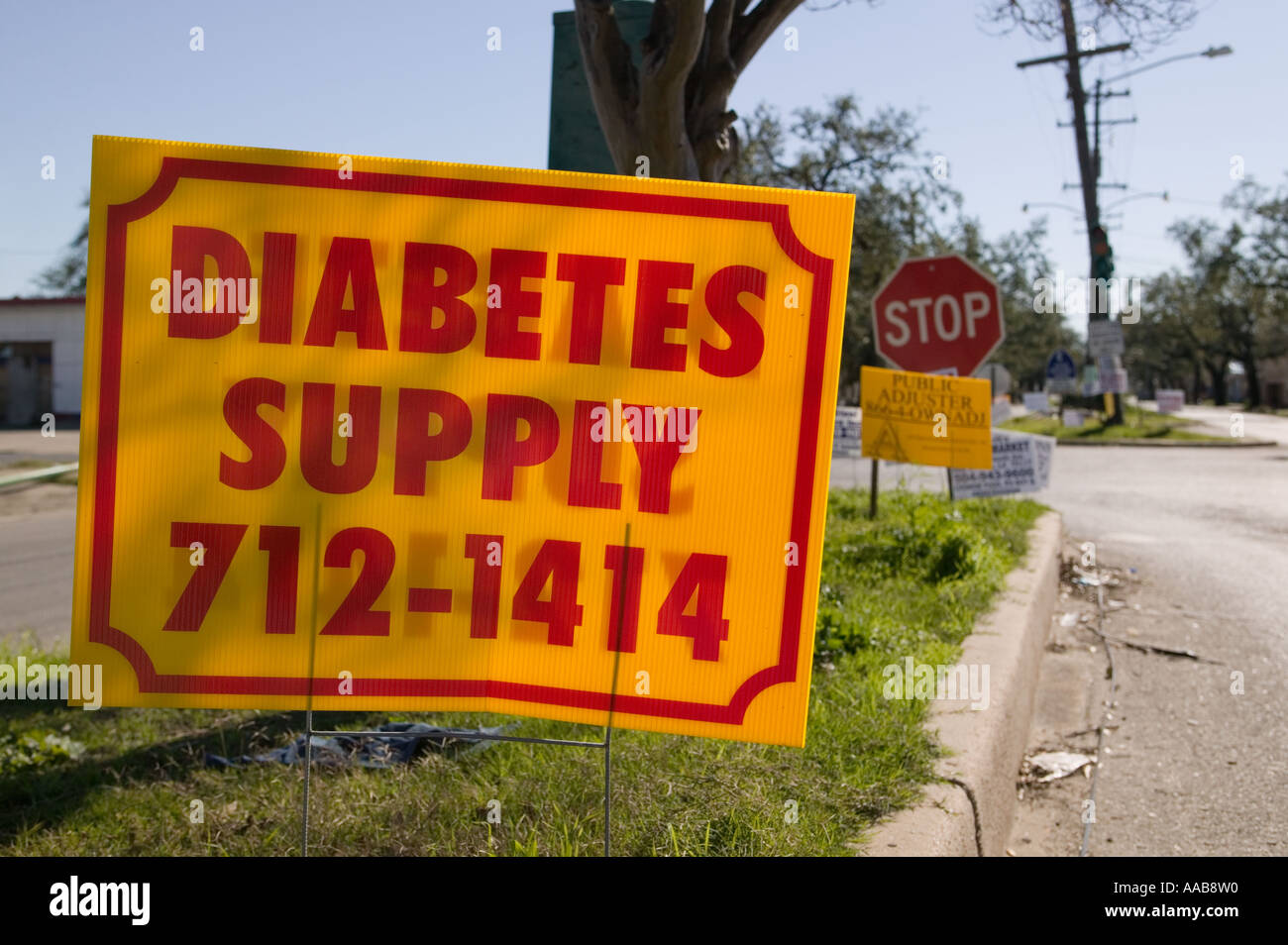 Advertising placards promoting diabetes supplies and services in the Bywater neighborhood of New Orleans Louisana - Stock Image