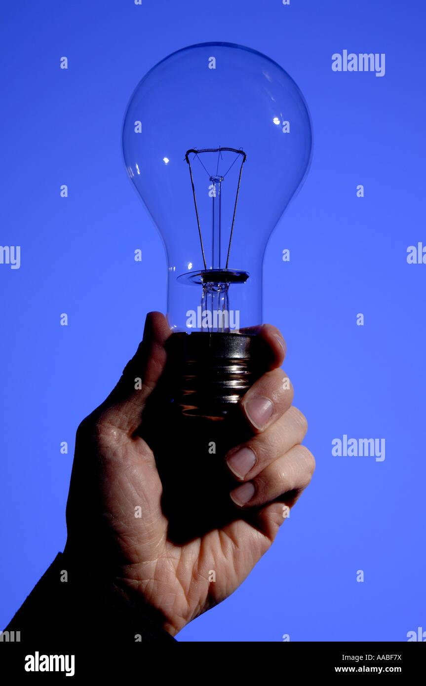 Hand holding large lightbulb - Stock Image
