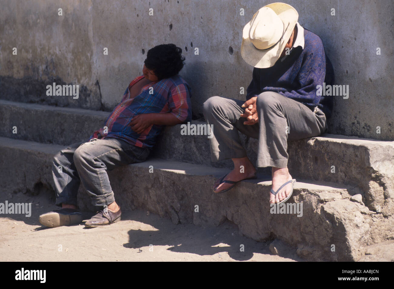Two men resting during siesta time at Santiago Atitlan Guatemala - Stock Image