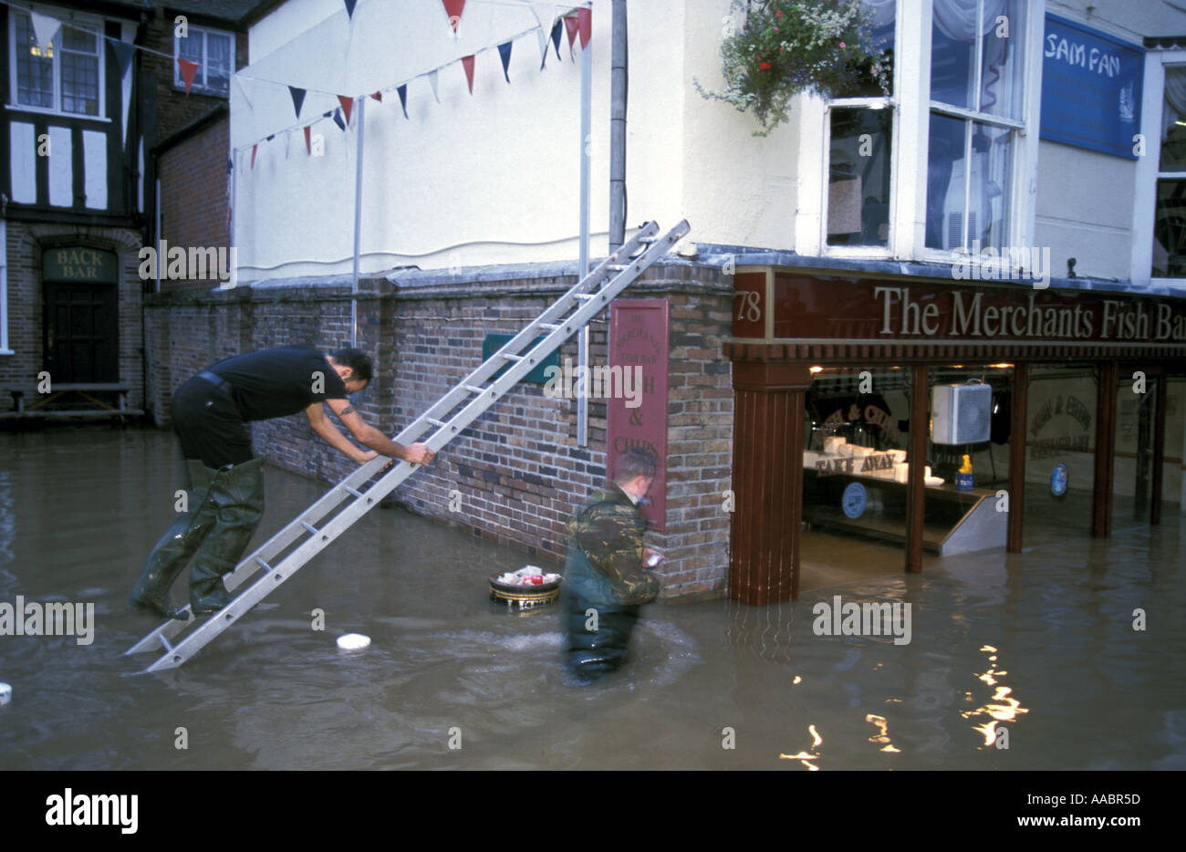 Recovering posessions from his flat above flooded shops in Bewdley after river seven floods the village Worcestershire - Stock Image