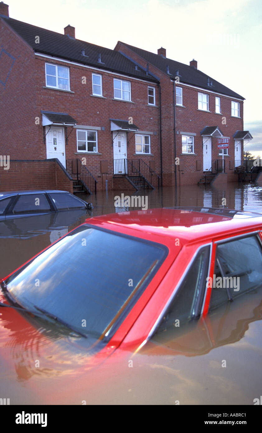Flooded cars and houses in Upton Upon Severn Worcestershire after the river Severn bursts its banks - Stock Image