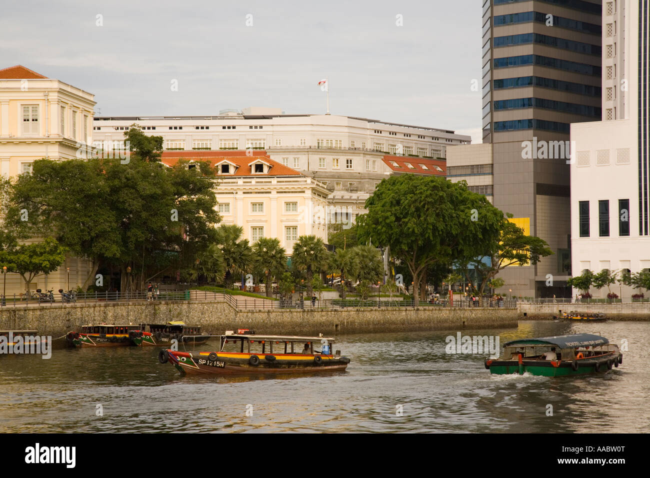 Bumboat River Taxis giving tourist cruises past Asian Civilisations Museum on North Boat Quay, Civic District, Singapore - Stock Image