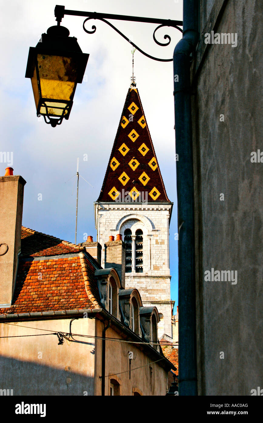 Church spire with classic decorative tiles Nuit Saint Georges Burgundy France - Stock Image