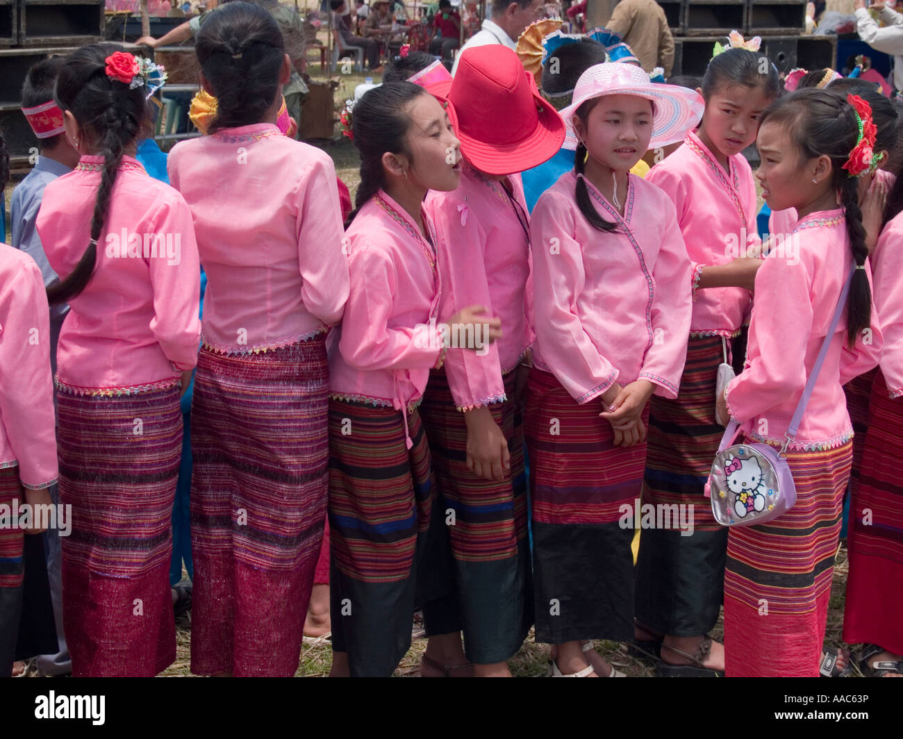 a lineup of traditional Lao skirts worn by girls at the Bun Bang Fai Rocket Festival Muang Singh Laos - Stock Image