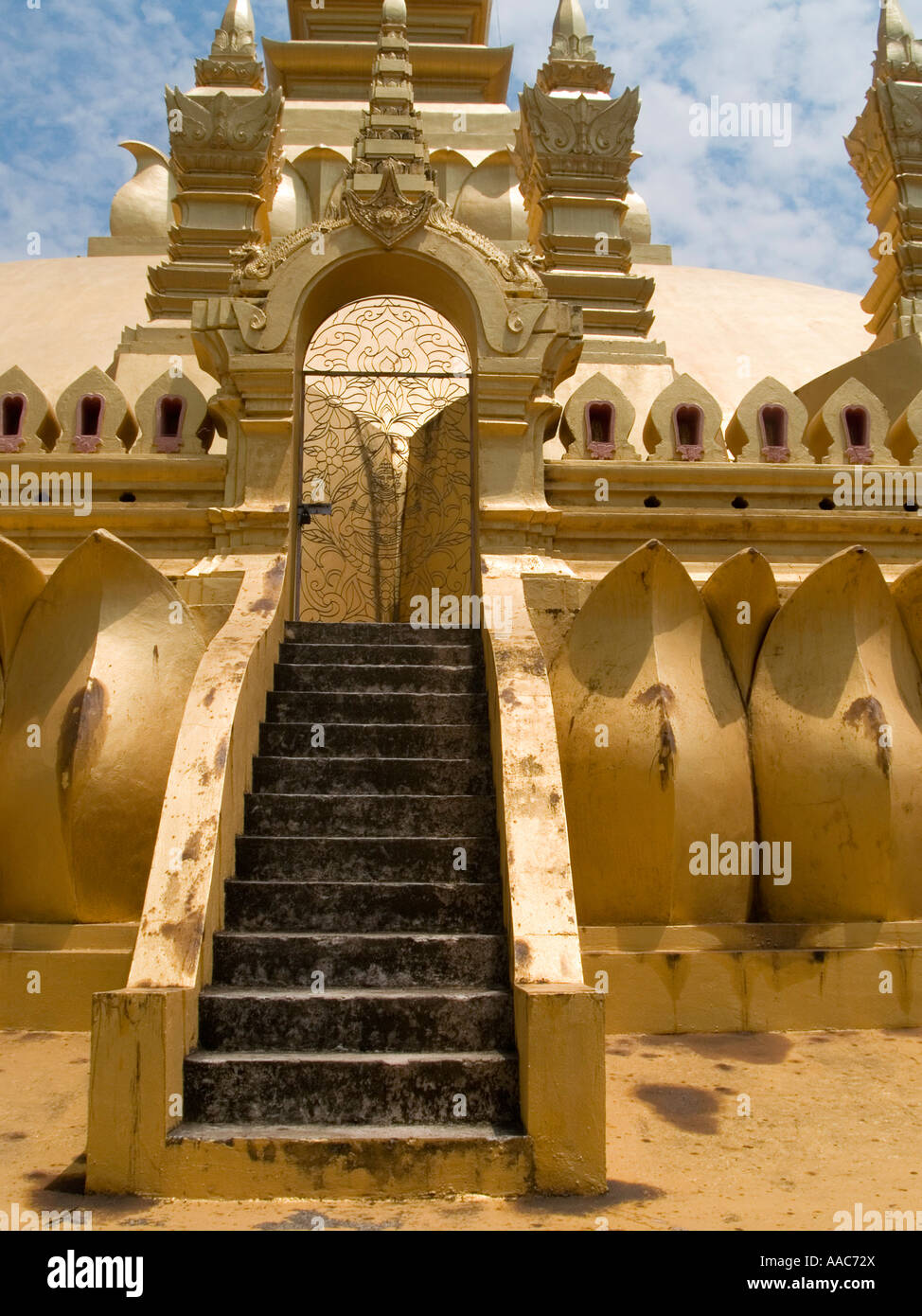 stairway to heaven stairs leading to top of golden That Luang Temple most revered place in Laos - Stock Image