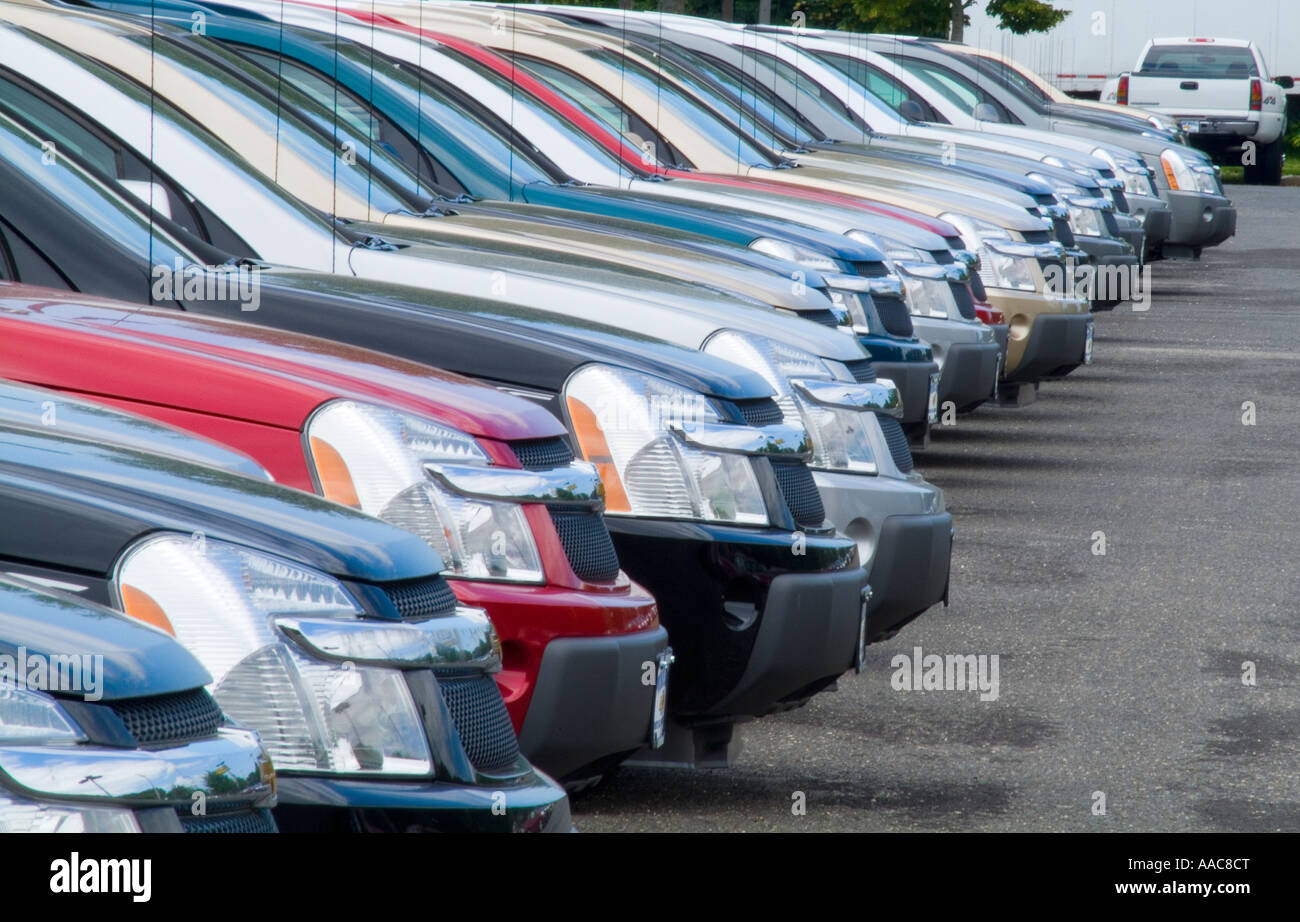 rows of new cars for sale in new car dealership parking. Black Bedroom Furniture Sets. Home Design Ideas