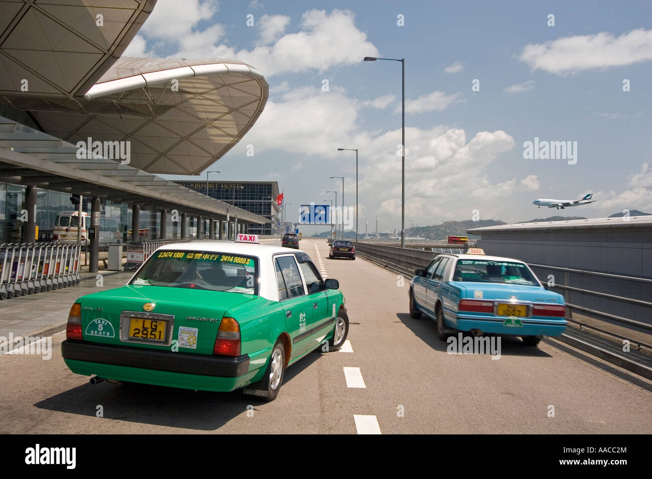 Taxis and plane Chek Lap Kok airport Hong Kong - Stock Image