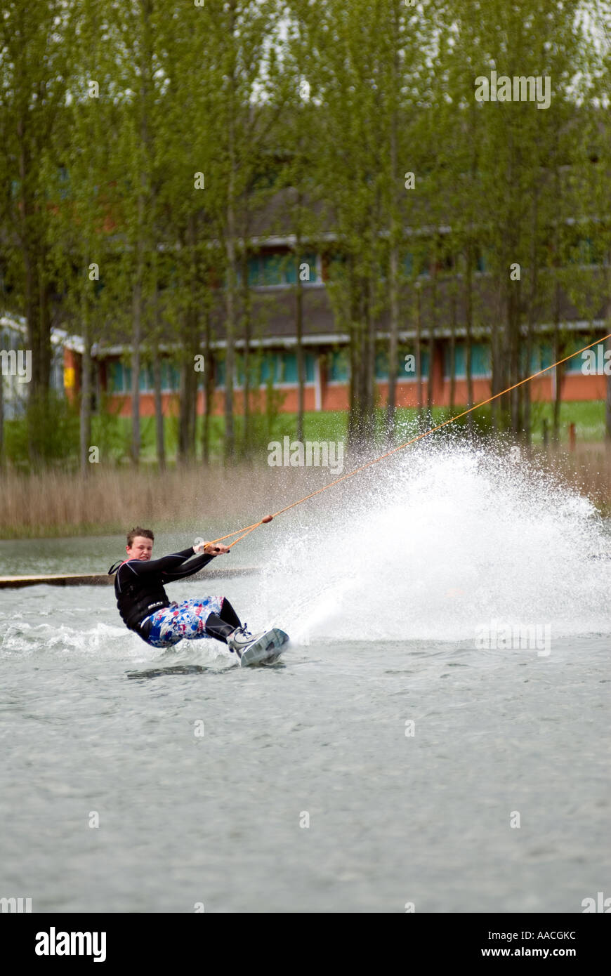 wakeboard wakeboarding extreme xtreme action sport spray Willen Lake water Milton Keynes MK - Stock Image
