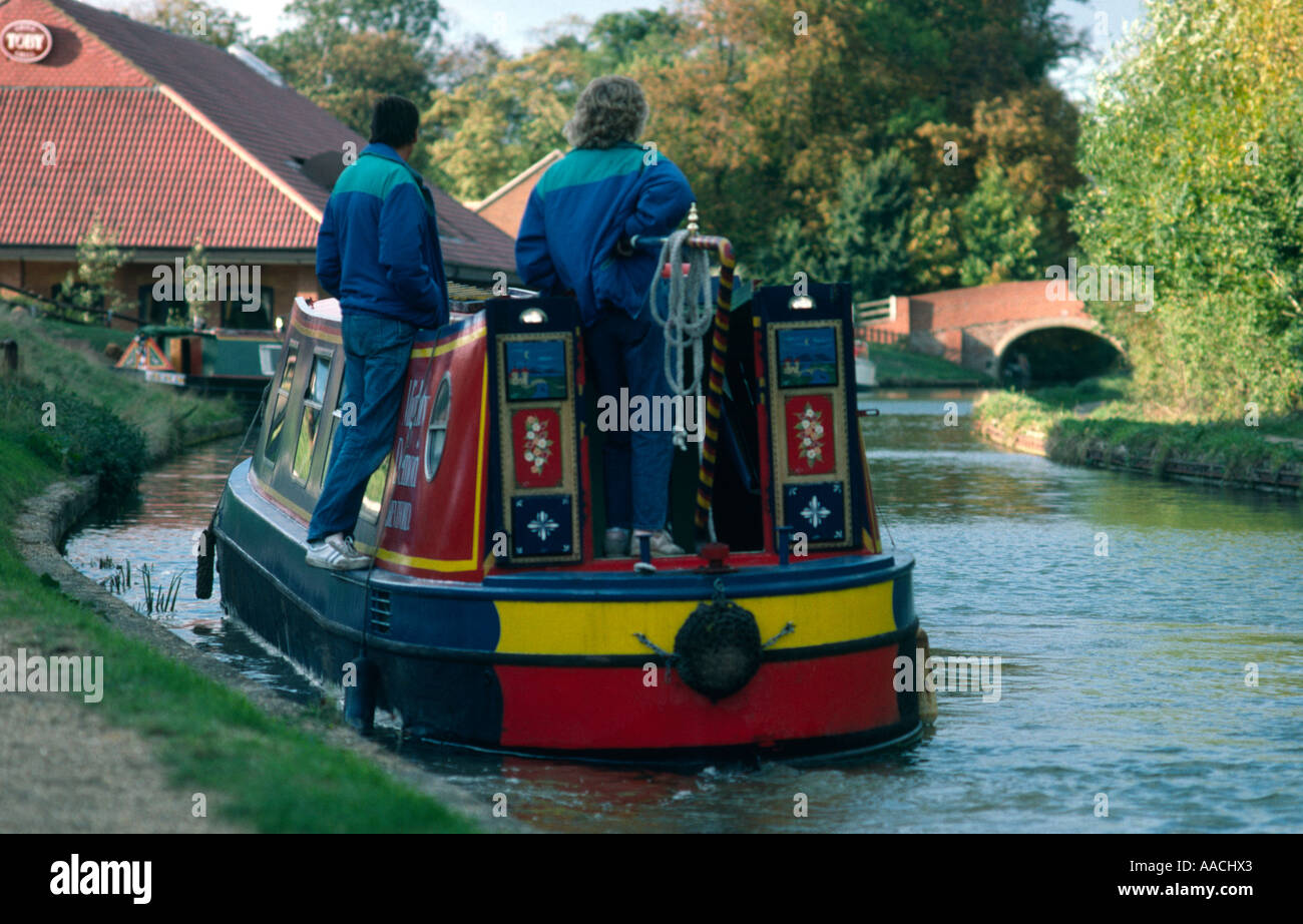 Narrowboat navigating the Grand Union Junction Canal in Milton Keynes - Stock Image