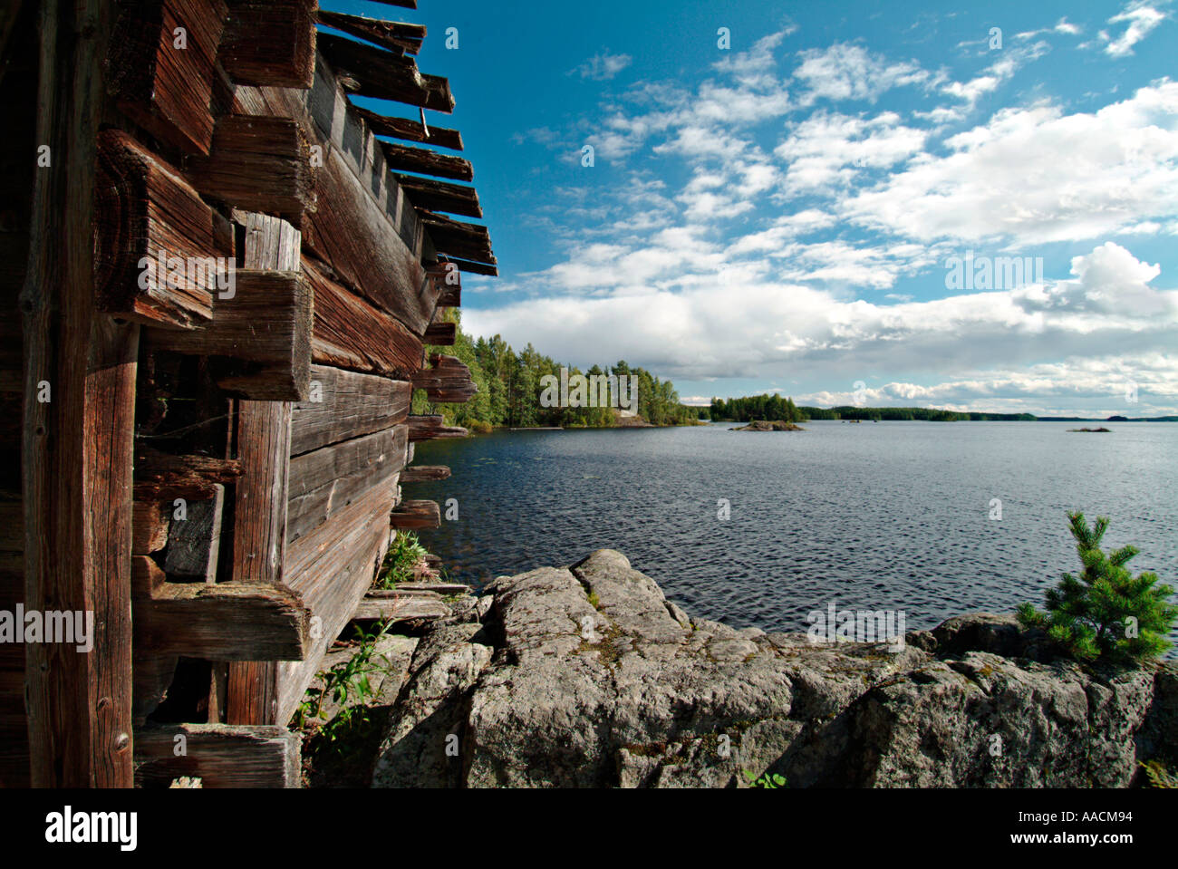 old wooden hut on rocks on the lakefront of a lake in Saimaa region in Finland Stock Photo
